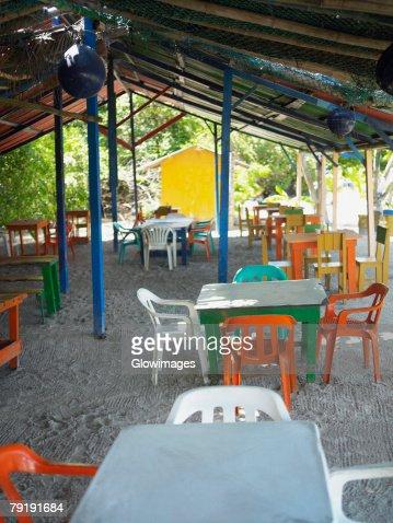 Empty tables and chairs in a restaurant, Providencia, Providencia y Santa Catalina, San Andres y Providencia Department, Colombia : Foto de stock