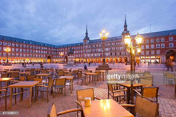 Empty tables in Plaza Mayor, Madrid at dusk
