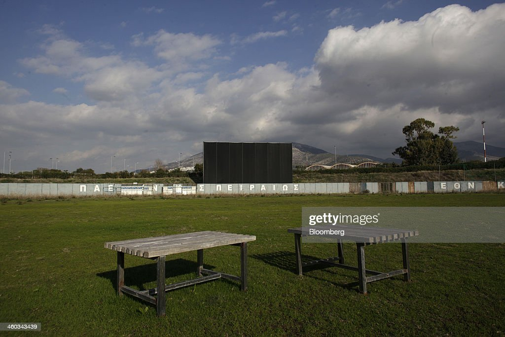 Empty tables stand in an abandoned hockey field near the former Athens International Airport in the Hellenikon district of Athens, Greece, on Friday, Dec. 3, 2014. Hellenikon is the largest of Greece's land development projects, three times the size of the Principality of Monaco. Photographer: Kostas Tsironis/Bloomberg via Getty Images