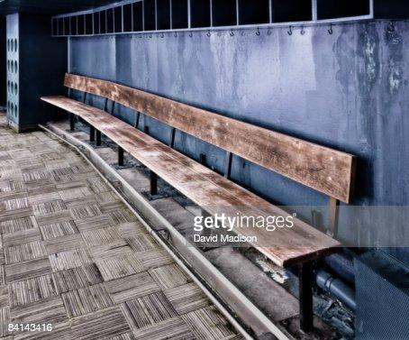 Empty team bench in baseball dugout.