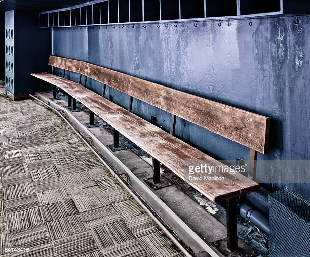 Empty team bench in baseball dugout.