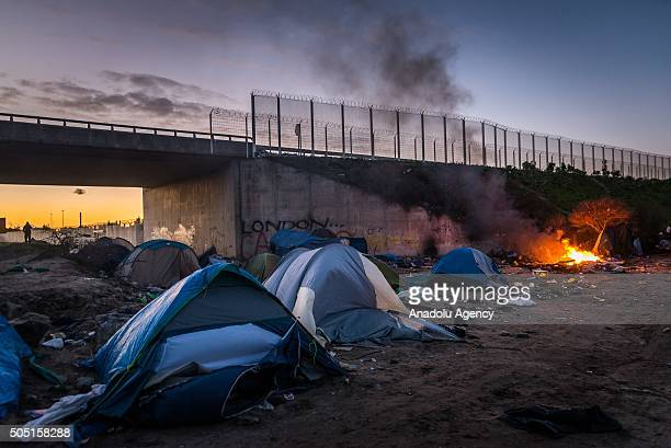 Empty tents are seen near the entrance of the camp known as the Jungle on January 15 2015 in Calais France French police have given residents a...