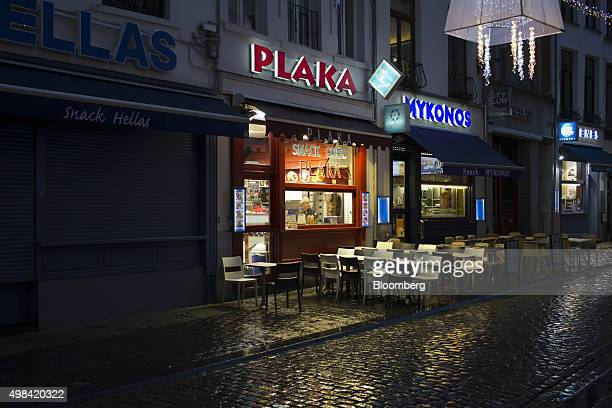 Empty terrace seating sits illuminated outside kebab restaurants near Grand Place square in Brussels Belgium on Sunday Nov 22 2015 The search for a...