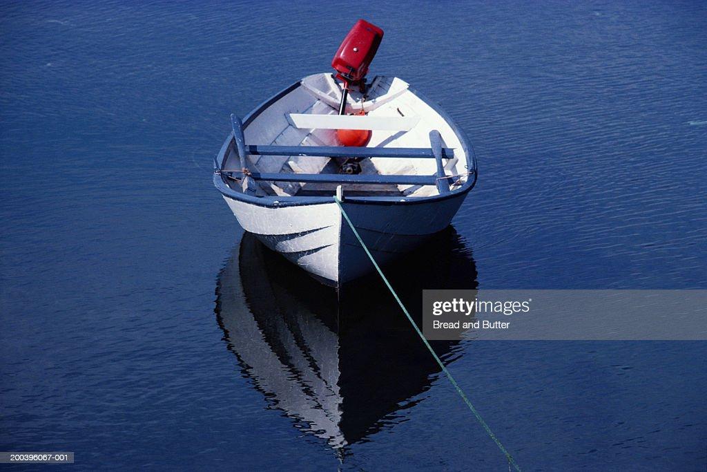 Empty tethered rowboat : Stock Photo