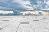 empty tiled floor with cloudy sky
