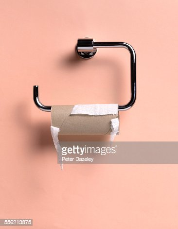 Empty toilet roll holder close up