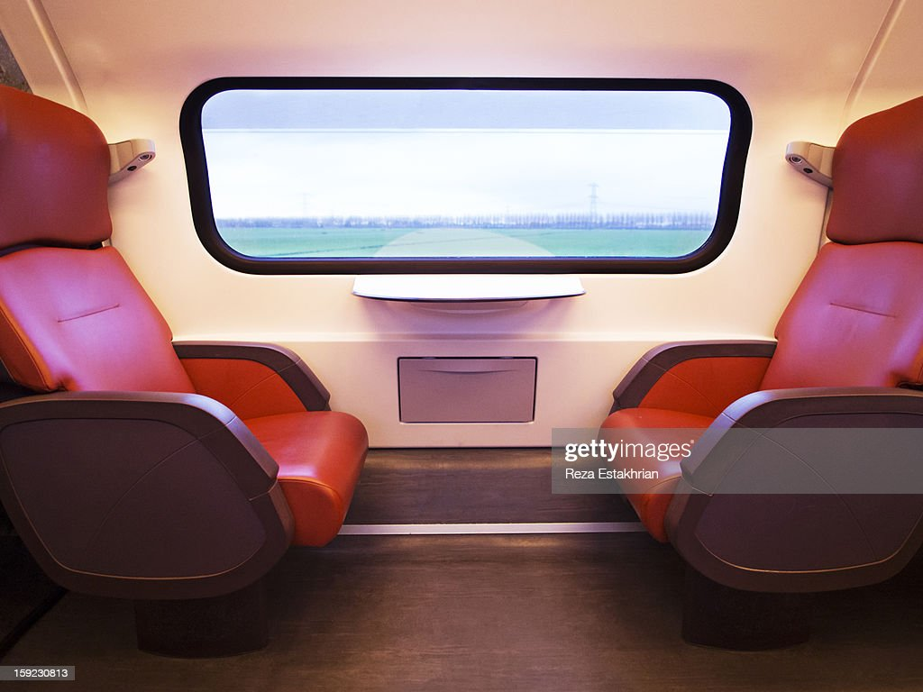 Empty train seats as scenery goes by : Stock Photo