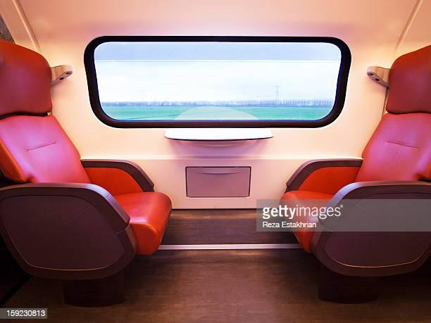 Empty train seats as scenery goes by