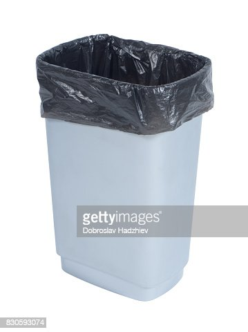 Empty trash container with black plastic bag on white background : Stock Photo