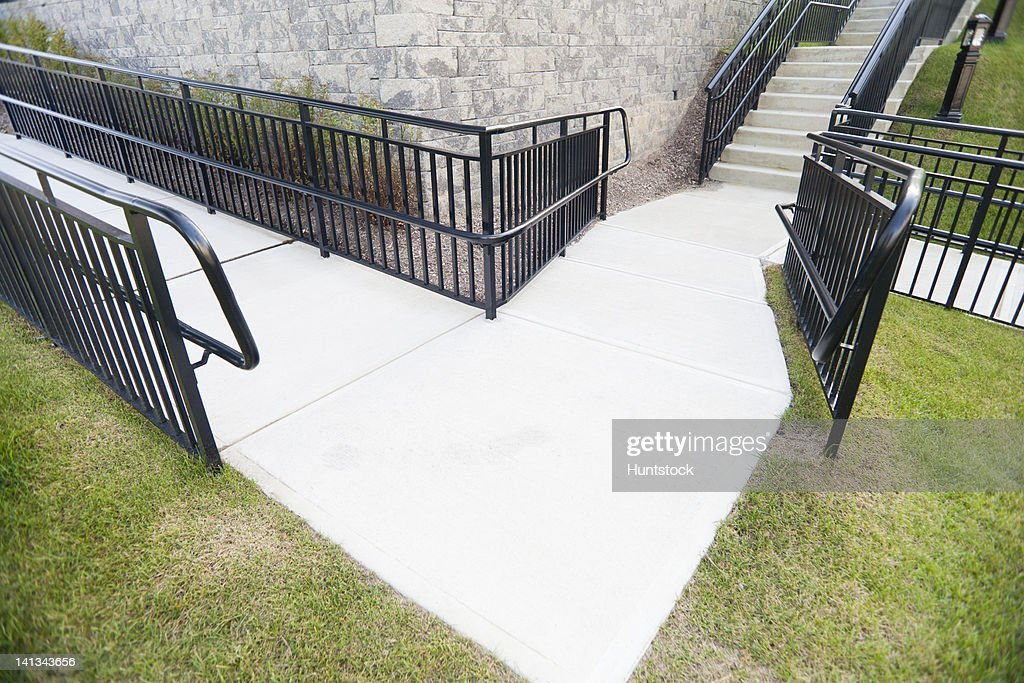 Empty Turn In Double Wheelchair Ramp Approaching Stairs : Stock Photo