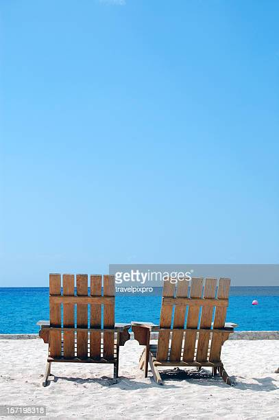 Empty Vacation Beach Chairs on Caribbean White Sand Copy Space