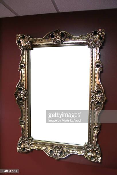 Empty vintage picture frame on wall