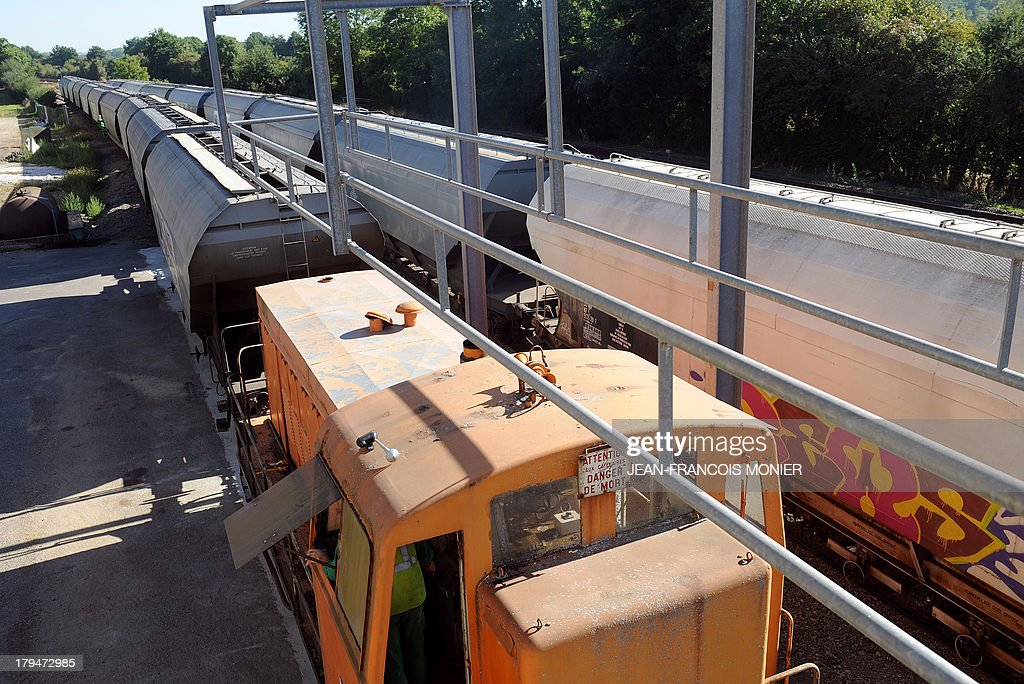 Empty wagons are loaded with wheat by Agrial, an agricultural cooperative on september 4, 2013 in Coulombiers, Western France. Some 1200 tonnes of wheat are loaded into 21 wagons and transported directly to the cooperative rather than by road to ease congestion.