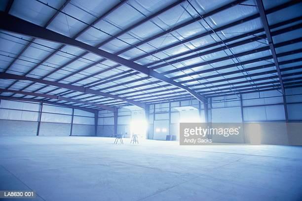Empty warehouse, doors open