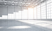 Vast Empty warehouse for car aor placment of automobile, sun light coming through windows