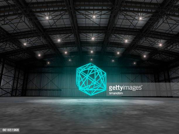 Empty warehouse with geometry floating