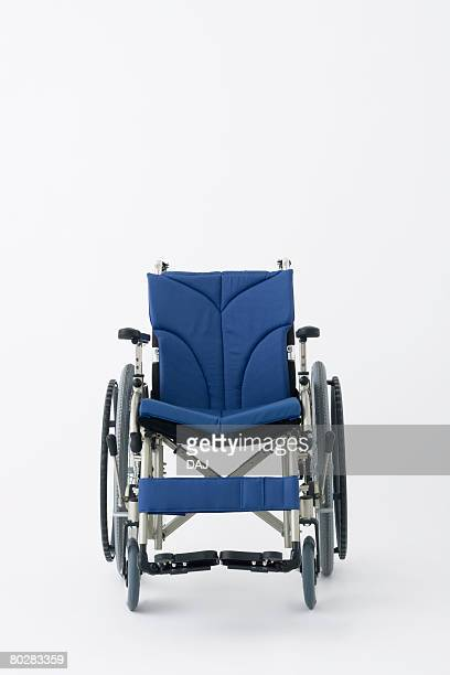 Empty wheelchair, white background, copy space