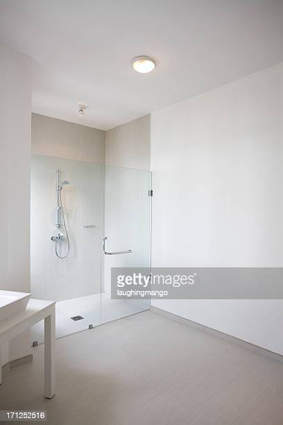 Empty white background with a shower with a glass door
