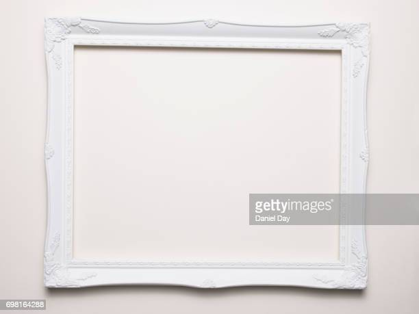 Empty white frame on a white background