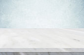 Empty white marble table over green cement wall background, banner, table top, shelf, counter design for product display montage