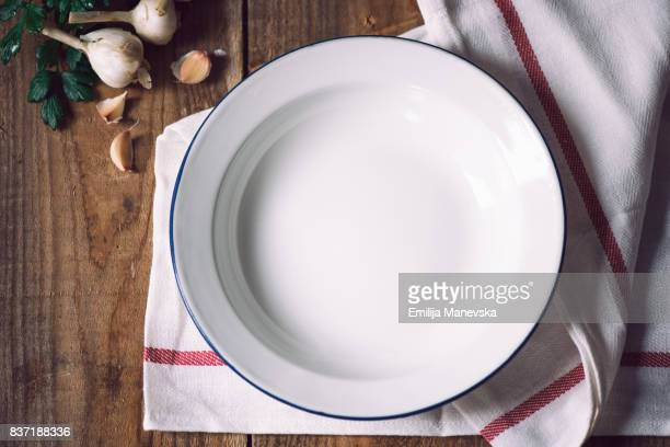 Empty white metal plate with napkin