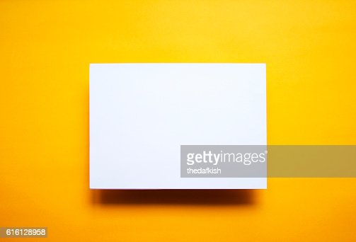Empty white paper sheet isolated yellow background : Photo