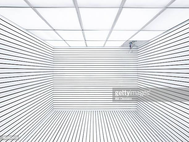 empty white room missing light with mangled wires