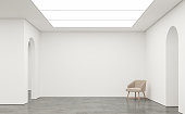 Empty white room modern space interior 3d rendering image.White room Many rooms are connected with arch shape door.There are poliished concrete floor,white wall