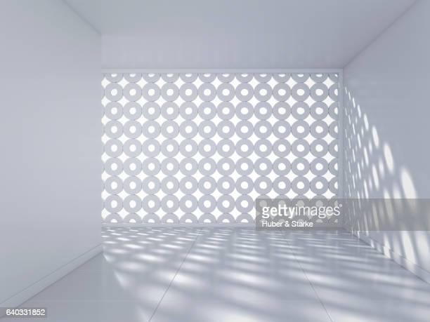 Empty white room with latticed window