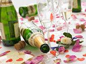 Empty Wine Bottles Among Rose Petals
