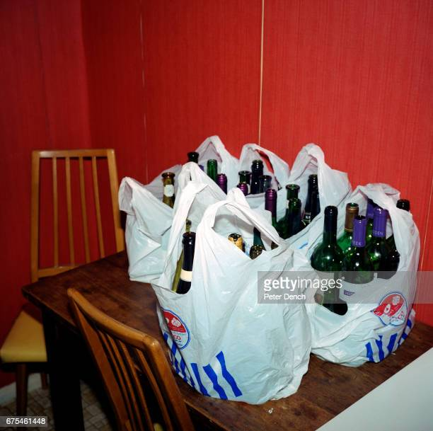 Empty wine bottles at a home are packed for recycling April 2002