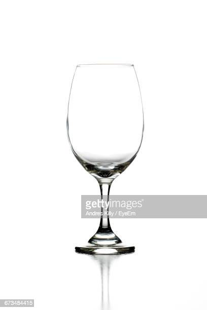 Empty Wineglass Against White Background
