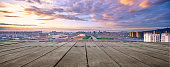empty wooden floor with cityscape of hangzhou in colorful cloud sky