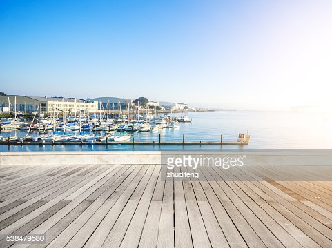 empty wood floor with sail boat in sunny day : Stock Photo