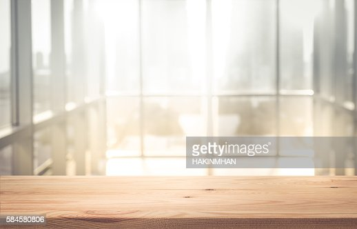 Empty wood table top with blur sunlight in window building : Stock Photo