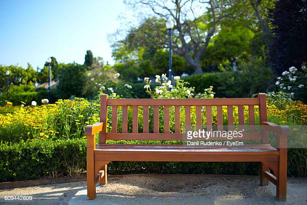Empty Wooden Bench At Park