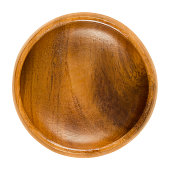 Empty wooden bowl. Small brown bowl with wood grain in simple design. Round open-top container for storing food and non-food items. Isolated macro photo close up from above on white background.