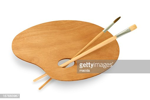Empty wooden painters palette with brushes on white