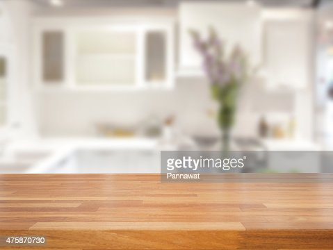 Kitchen Table Close Up Empty Wooden Table And Blurred Kitchen Background Stock Photo