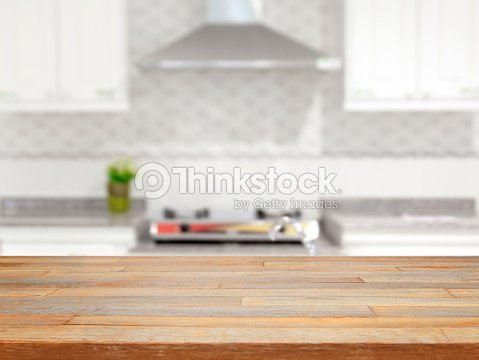Empty wooden table and blurred kitchen background   Stock Photo. Empty Wooden Table And Blurred Kitchen Background Stock Photo