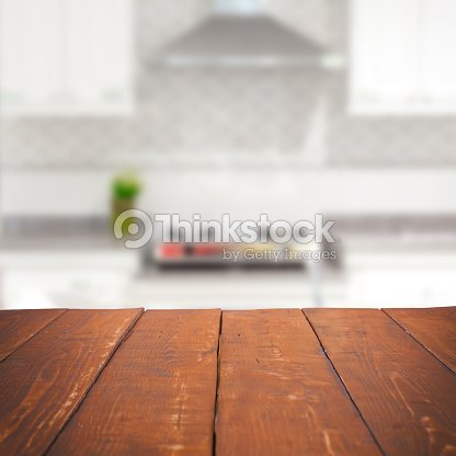 Empty wooden table and blurred kitchen background stock for Planner cucina gratis