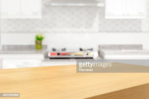 Kitchen Table Background empty wooden table and blurred kitchen background stock photo