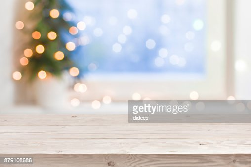 Empty wooden table in front of blurred winter holiday background : Stock Photo