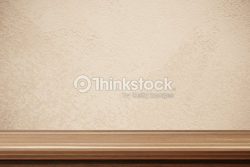 Empty Wooden Table Over Brown Cement Wall Background