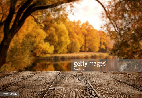 Empty wooden table over the autumn landscape : Stock Photo