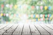 Empty wooden table with party in garden background blurred.Empty wooden table with party in garden background blurred.
