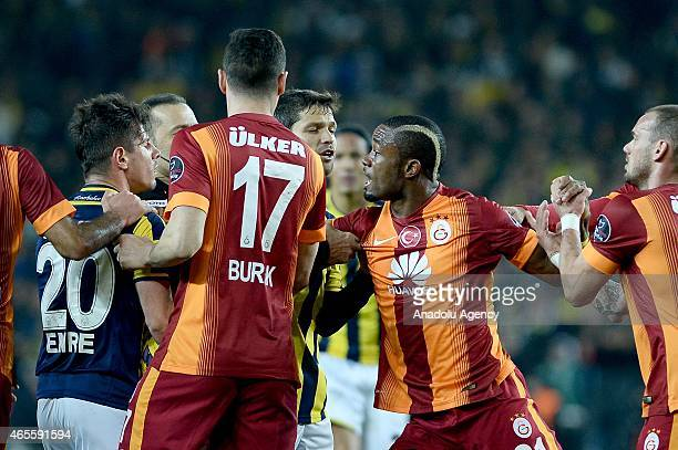 Emre Belozoglu of Fenerbahce and Aurelien Chedjou of Galatasaray argue with each other during the Turkish Spor Toto Super League derby game between...