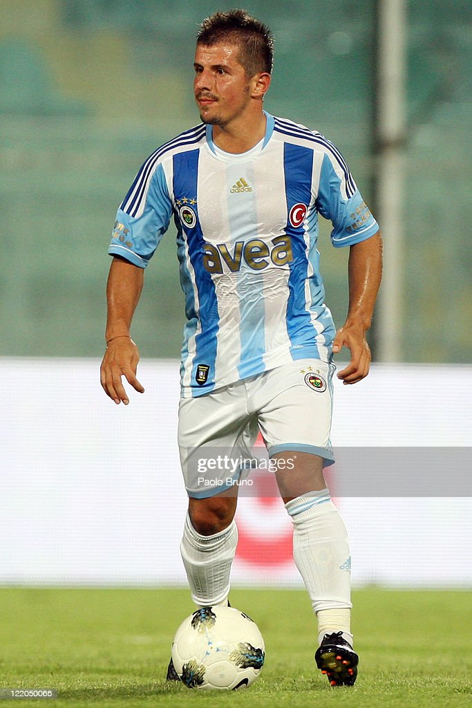 <a gi-track='captionPersonalityLinkClicked' href=/galleries/search?phrase=Emre+Belozoglu&family=editorial&specificpeople=649491 ng-click='$event.stopPropagation()'>Emre Belozoglu</a> of Fenerbahce in action during the pre season friendly match between Us Citta di Palermo and Fenerbahce at Stadio Renzo Barbera on August 21, 2011 in Palermo, Italy.