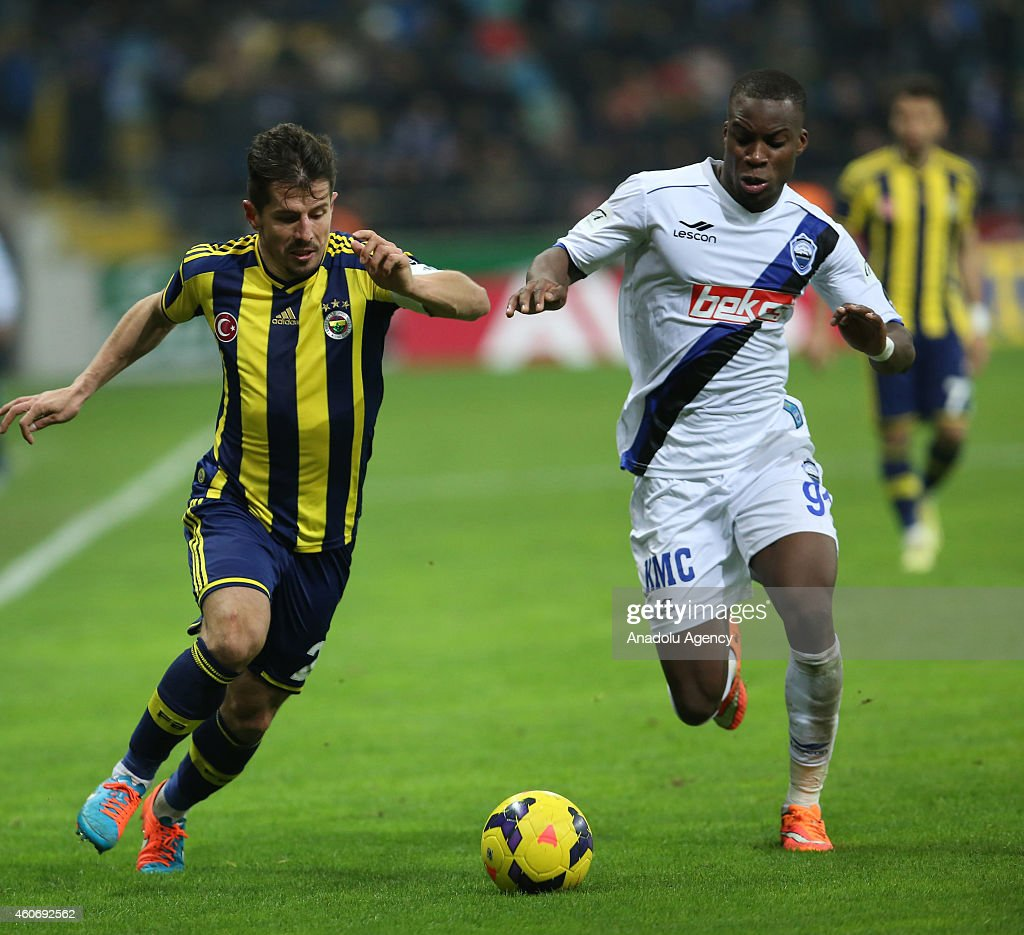 <a gi-track='captionPersonalityLinkClicked' href=/galleries/search?phrase=Emre+Belozoglu&family=editorial&specificpeople=649491 ng-click='$event.stopPropagation()'>Emre Belozoglu</a> (L) of Fenerbahce in action during the Turkish Spor Toto Super League football match between Suat Altin Insaat Kayseri Erciyesspor and Fenerbahce at Kadir Has Stadium in Kayseri, Turkey, on December 19, 2014.