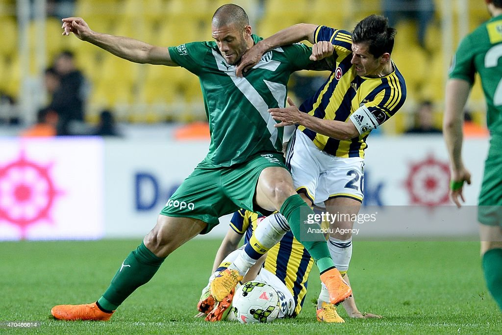 <a gi-track='captionPersonalityLinkClicked' href=/galleries/search?phrase=Emre+Belozoglu&family=editorial&specificpeople=649491 ng-click='$event.stopPropagation()'>Emre Belozoglu</a> of Fenerbahce (R) is in action with Fernando of Bursaspor (L) during the Turkish Spor Toto Super League football match between Fenerbahce and Bursaspor at Sukru Saracoglu Stadium in Istanbul, Turkey on April 20, 2015.